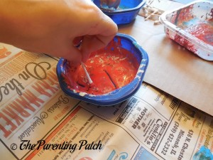 Dipping the Cotton Swabs in Red, White, and Blue Paint