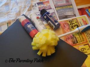 Foam Dish Brush, Acrylic Paint and Black Construction Paper
