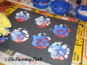 Stamping Red, White, and Blue Fireworks with Foam Dish Brush
