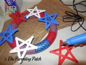Gluing the Red, White, and Blue Stars to the Patriotic Foam Wreath