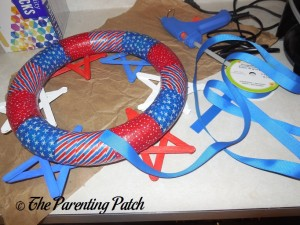 Gluing Red, White, and Blue Ribbon to the Patriotic Wreath