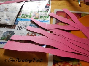 Cutting the Red Paper into Wiggly Strips