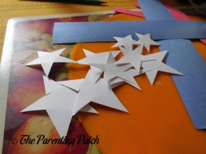 Cutting White Construction Paper Stars