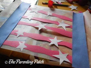 Gluing White Stars on the Red Wiggly Strips