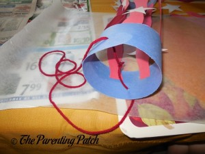 Adding the Yarn to the Paper Lantern
