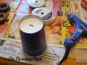 Poking a Hole in the Disposable Cup for the Patriotic Cup Lantern Craft