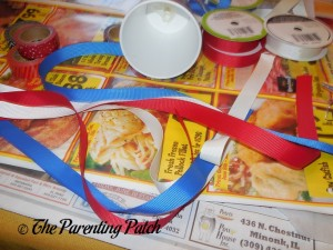 Cutting Ribbon for the Patriotic Cup Lantern Craft