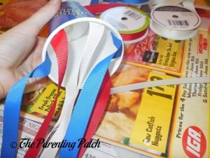 Gluing Ribbon to the Cup for the Patriotic Cup Lantern Craft
