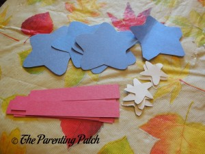 Cutting Paper Pieces for Star Person Craft