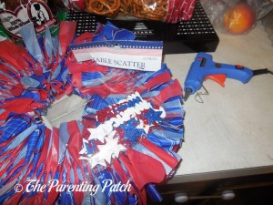 Gluing Patriotic Table Scatter to the Fourth of July Wreath Craft