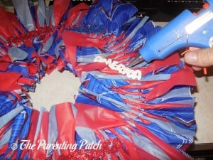 Gluing More Patriotic Table Scatter to the Fourth of July Wreath Craft