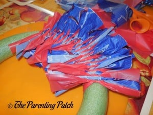 Adding Even More Table Cloth Strips for the Fourth of July Wreath Craft