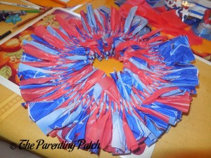 Foam Wreath Covered in Table Cloth Strips for Fourth of July Wreath Craft
