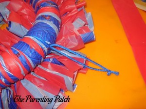 Tying a Yarn Hanger to the Fourth of July Wreath Craft