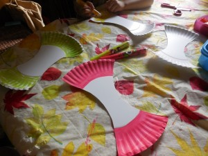 Coloring the Paper Plate for the A Is for Apple Paper Plate Craft