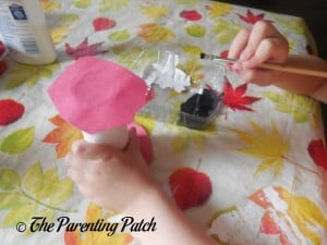 Painting Black Seeds on the White Toilet Paper Tube 1