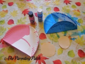 Painting the Paper Plate for the B Is for Baby Paper Plate Craft