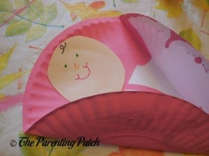 Gluing Together the Baby Paper Plate Crafts