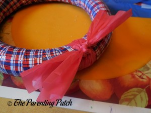 Knotting Red Tablecloth Strips for Patriotic Wreath Craft