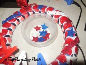 Gluing Glitter Table Scatter to Patriotic Craft Stick Star Wreath