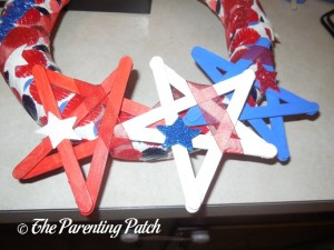 Adding Finishing Touches to Patriotic Craft Stick Star Wreath