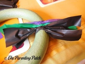 Adding Even More Tablecloth Strips for the Tablecloth Ribbon Halloween Wreath Craft