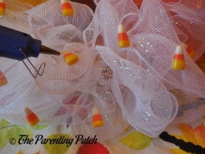 Attaching Fake Candy Corn to the Deco Mesh Candy Corn Wreath Craft
