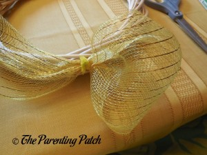 Attaching Yellow Deco Mesh to the Deco Mesh Candy Corn Wreath Craft 1