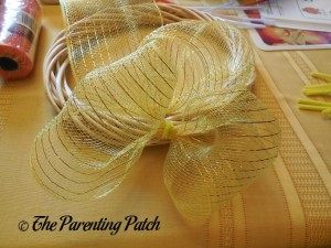 Attaching Yellow Deco Mesh to the Deco Mesh Candy Corn Wreath Craft 2