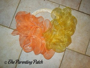 Yellow and Orange Deco Mesh on the Deco Mesh Candy Corn Wreath Craft