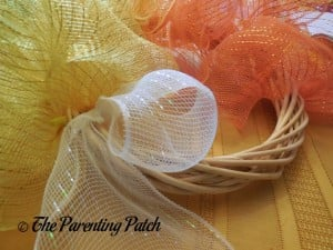 Attaching White Deco Mesh to the Deco Mesh Candy Corn Wreath Craft