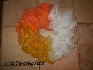 Yellow, Orange, and White Deco Mesh on the Deco Mesh Candy Corn Wreath Craft