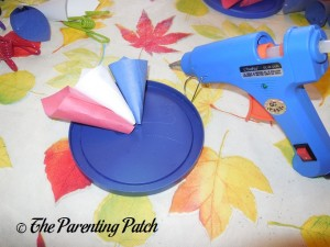 Gluing the Paper Cones for the Patriotic Rolled Paper Wreath Craft