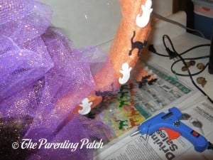 Gluing Halloween Foam Stickers on the Sparkle Tulle Halloween Wreath Craft