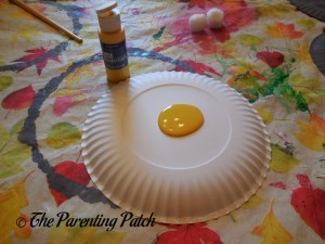 Painting a Paper Plate Yellow