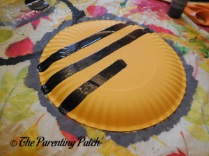 Painting Black Stipes on the Yellow Plate