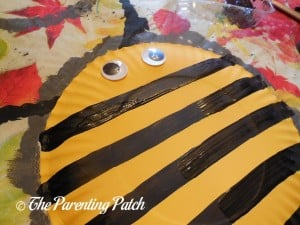Gluing Wiggle Eyes to the Striped Plate