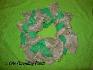 Adding the Green Burlap Ribbon to the Burlap and Ribbon St. Patrick's Day Wreath