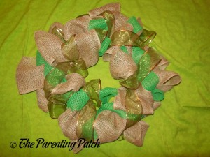 Adding the Green Ribbon to the Burlap and Ribbon St. Patrick's Day Wreath