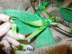 Adding the Ribbon Hanger to the Burlap and Ribbon St. Patrick's Day Wreath
