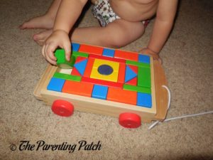 Playing with PSA Toddler Pull-Along Trailer with Wooden Blocks 1