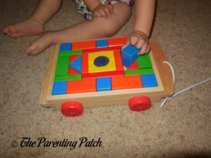 Playing with PSA Toddler Pull-Along Trailer with Wooden Blocks 2