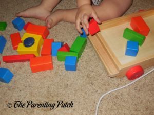 Playing with PSA Toddler Pull-Along Trailer with Wooden Blocks 3