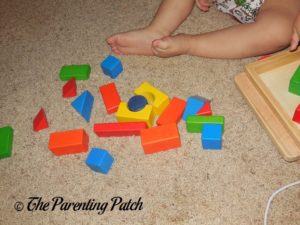 Playing with PSA Toddler Pull-Along Trailer with Wooden Blocks 4