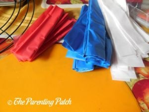 Tablecloth Strips for Red, White, and Blue Wreath Craft