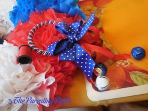 Adding Door Knob Hanger to Red, White, and Blue Wreath Craft