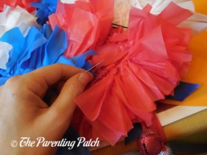 Sewing Door Knob Hanger to Red, White, and Blue Wreath Craft