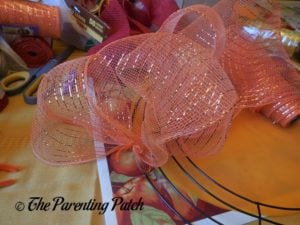 Second Deco Mesh Loop of Deco Mesh and Burlap Ribbon Autumn Wreath Craft