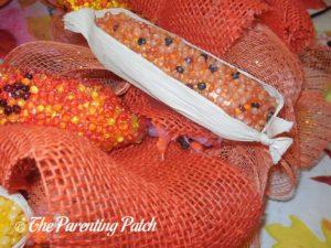Gluing Indian Corn to Deco Mesh and Burlap Ribbon Indian Corn Autumn Wreath Craft