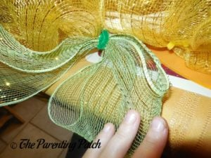 Adding Green Burlap Ribbon to Deco Mesh and Ribbon Autumn Wreath Craft